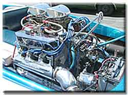 FE Engine has a Tunnelwedge with 2 750 Holley carbs, Edelbrock heads. 640hp on pump gas.